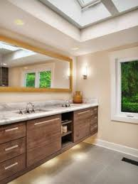 how to light a contemporary bathroom with wall sconces
