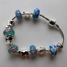 murano bead bracelet images Charm bracelet with turquoise murano glass beads go fli jpg