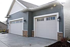 Style Garage by Carriage Style Garage Doors In Almond And Madison Window Inserts