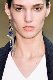 one earring one sided the single earring trend to try for fall thefashionspot