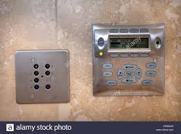 a touch sensitive waterproof control panel in the bathroom of a