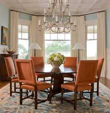 charleston rust orange curtains dining room traditional with round