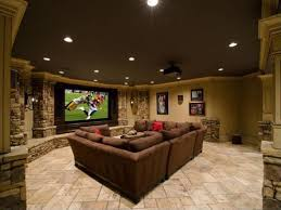 rustic man cave with wall sconce ceiling mounted projector