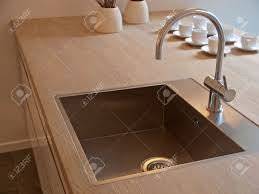 details of modern design trendy kitchen sink with water tap stock