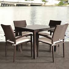 dark brown wicker dining set with square table and glass top
