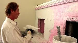 structo lite plaster render over a brick or cinderblock fireplace