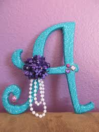peacock colored sparkly yarn wrapped wood letter with purple pink