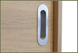 a flush door handle for the closet door in the craft room door