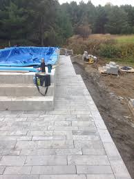 Pools Patios And Spas by Interlock Patio Around A New Semi Above Ground Lap Pool Master