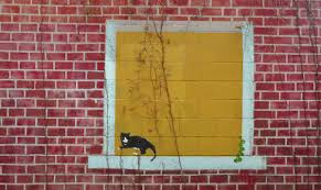 how to paint a brick wall mural the secret to a faux brick wall mural painted on the side of a garage it has been painted to look like