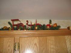 Decor Above Kitchen Cabinets Decorating Above Kitchen Cabinets With Flowers Giesendesign Com