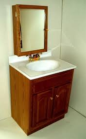 Corner Bathroom Sink Cabinets by Attractive Small Corner Bathroom Sink With Cabinet Using Walnut
