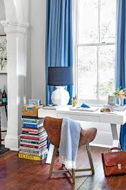 50 best small space decorating tricks we learned in 2016 books stacked in corner