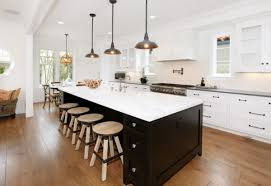 lighting two tone kitchen cabinets and large kitchen island with