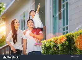 Beautiful Family Beautiful Family Portrait Smiling Outside Their Stock Photo