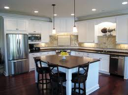 wood countertops kitchen layouts with island lighting flooring