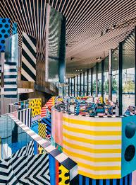 accent chairs blue and purple kitchen accessories wonderful camille walala transforms this london gallery into a trippy advertisement
