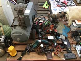 Chainsaw Bench Grinder Pallet Lot Air Compressor Battery Chainsaw Bench Grinder And More