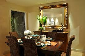 mirror dining with floral arrangement dining room contemporary and