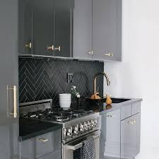 black kitchen cabinets with white subway tile backsplash this is how to rock a beautiful subway tile backsplash