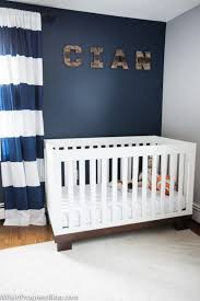 navy and gray nursery an accent wall with naval by sherwin