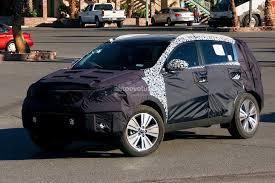 kia sportage interior spyshots 2014 kia sportage facelift gets revised interior