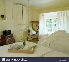 Cream And White Bedroom Wallpaper Breakfast Tray On Bed In Country Bedroom With Yellow Cream Striped