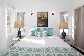 old fashioned wall art on center wall of traditional bedroom