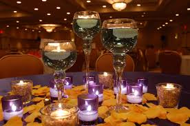 white flowers with white floating candles on glass jar for wedding