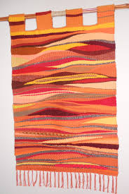 this wall hanging was done on a traditional floor loom but was