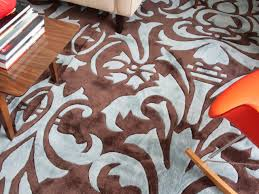 Living Room With Area Rug by How To Make One Large Custom Area Rug From Several Small Ones Hgtv