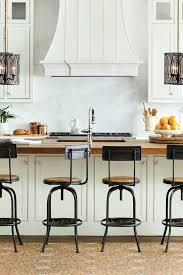 travertine countertops kitchen island table with stools lighting