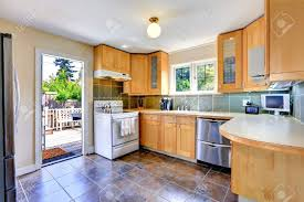 light brown kitchen cabinets modern modern light tone kitchen cabinets with white stove and steel