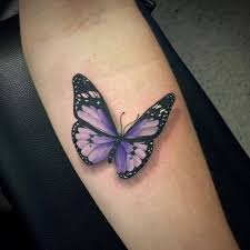 black and purple butterfly on forearm