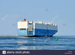 car carrier cargo ship excellent ace exiting the east end of the
