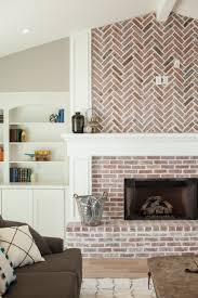 fireplace with herringbone pattern brick work and built in