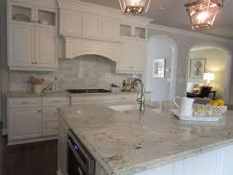 dark stone backsplash white cabinets with dark hardwood floors glass tile and stone