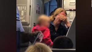 american airlines investigates after video shows mom in tears cnn