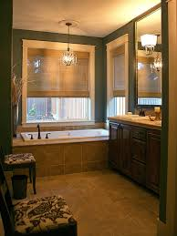 rental bathroom before after makeover with dark wall paint update your bathroom floor with a stencil bathroom makeover cheap bathroom updates