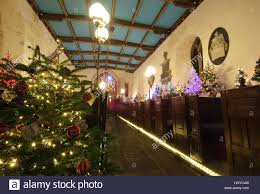 christmas tree festival at a church in a rural english village