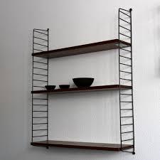 ladder shelf wall unit by nils strinning for string design ab
