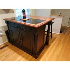 monarch kitchen island home styles monarch distressed oak and granite top black wooden