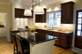 dark cherry cabinets kitchen eclectic with black counters eclectic