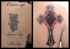 lower back cover up tattoos big cross cover up done by