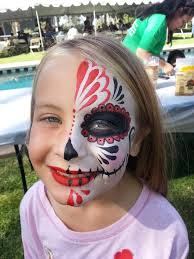 half sugar skull face paint by cynnamon in corona halloween