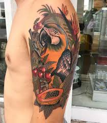 parrot tattoo on shoulder with fruits tattoo awesomeness
