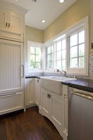 white beadboard kitchen cabinets beadboard kitchen cabinets traditional kitchen design savvy