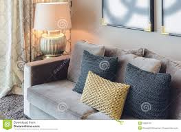 Gold Sofa Living Room by Gold And Black Color Pillows On Grey Sofa Stock Photo Image