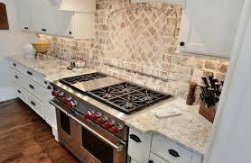 new white kitchen cabinets with brick backsplash taste