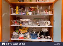 Kitchen Glass Cabinet by Messy Kitchen Glass Cabinet With Dishes Stock Photo Royalty Free